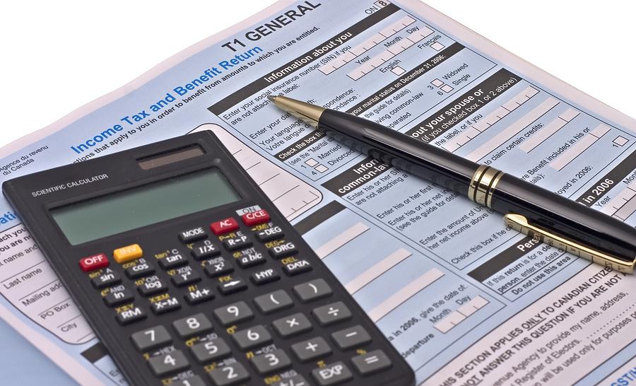 bigstock-Tax-Forms-1691023